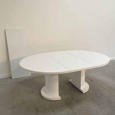 Round white extendable dining table by Läsko, 1970s