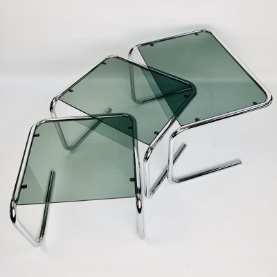 Geometrical set of 'floating' nesting tables in unusual U-shaped design