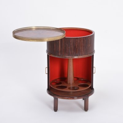 Circular Italian Mid-Century bar cabinet with sliding doors & swiveling tray