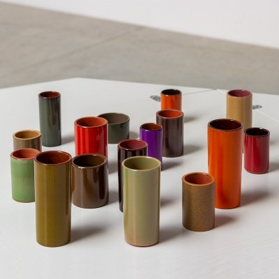 Collection of 16 ceramic cylinder vases, circa 1960