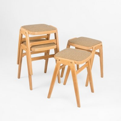 Set of 4 stackable upholstered stools, UK 1970's