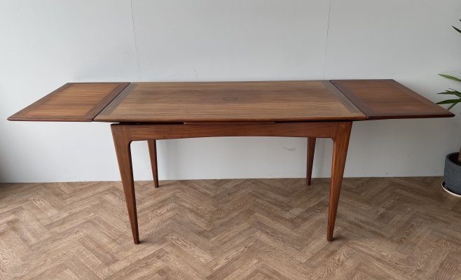 A. Younger mid century extending teak dining kitchen table