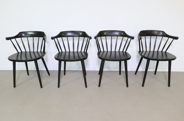 Black painted wooden arm chairs by Yngve Ekström