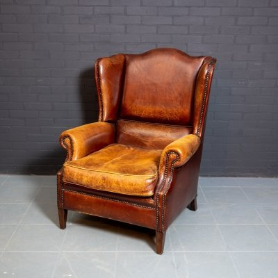 Vintage wing chair made of sheep leather