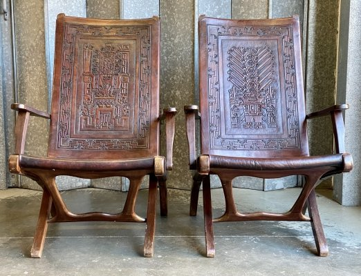 Pair of Angel Pazmino embossed leather & wood chairs, 1960s