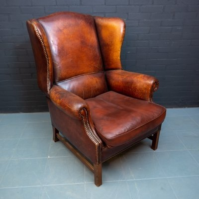 Vintage wing chair made of dark brown sheep leather