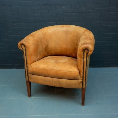 Vintage club chair made of light brown sheep leather