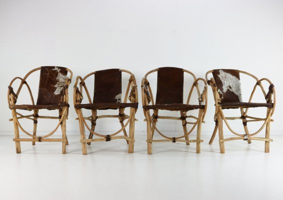 Four special handmade armchairs with cow skin seating & back