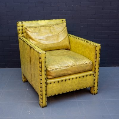 Large vintage faux leather armchair
