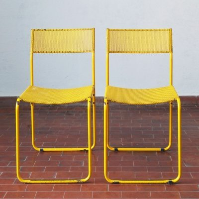 2 Yellow perforated metal garden chairs, 1970s