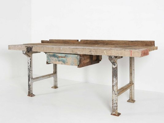 Large workbench with cast iron base & oak wooden top, 1930s