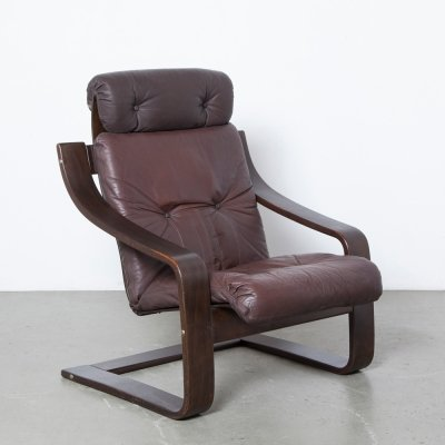 Model Anne armchair in brown leather
