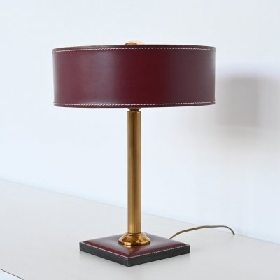 Jacques Adnet clad table lamp in red leather, France 1960