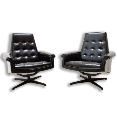 Pair of leather swivel armchairs by UP Zavody, 1970s