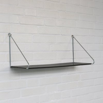 Wall mount book shelf in black perforated metal by Pilastro Holland