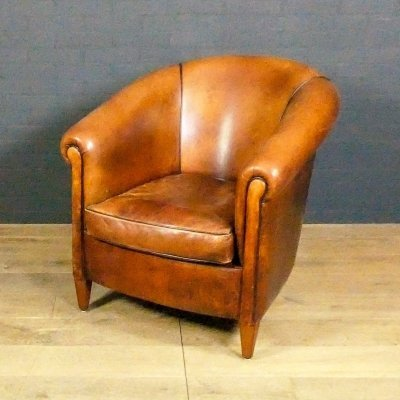 Vintage sheep leather club chair with dark piping