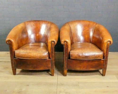 Set of 2 nailed sheep leather club chairs