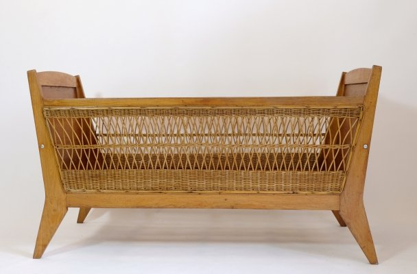 Wooden child's bed or crib with a rattan decor, 1960s