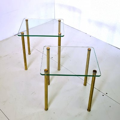 Pair of Hollywood regency side glass tables with brass legs, Italy 1970s