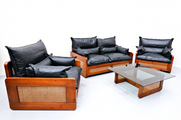 Italian mid-century living room set with Sofa, armchairs & coffee table in black leather, wood & caning, 1970s