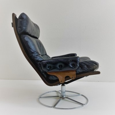 Swivel base leather lounge chair by Bruno Mathsson for Dux, Sweden 1970s