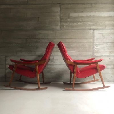 Two Scandinavian red faux leather rocking chairs