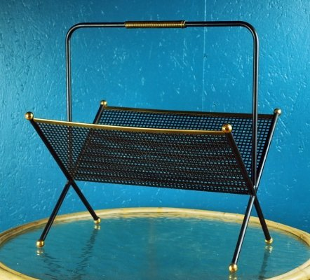 Magazine rack in black lacquered perforated metal
