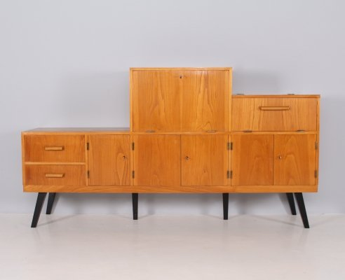 Asymmetric wood sideboard with multiple compartments, 1950's