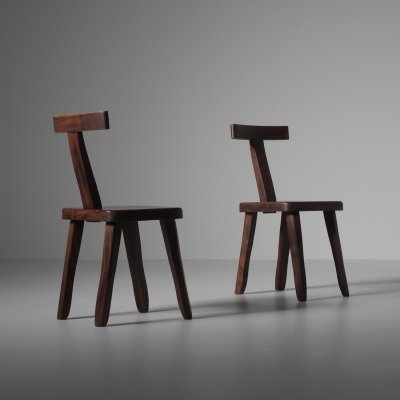 Sculptural side chairs in stained Elm
