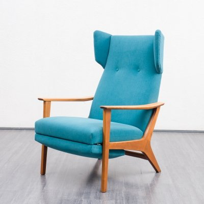 1960s wing chair with fold-out foot section