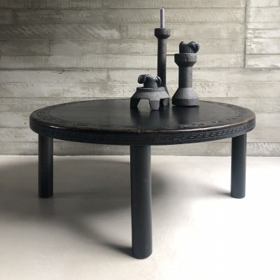 Saddle leather coffee table with a wooden base