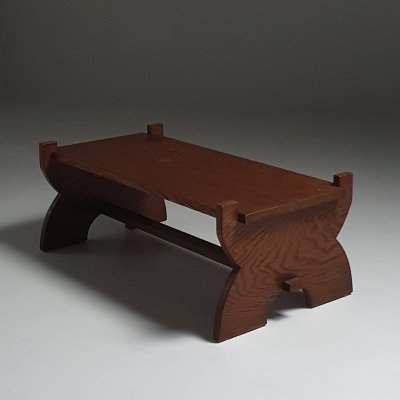 Sculptural 1930s coffee table in solid wood
