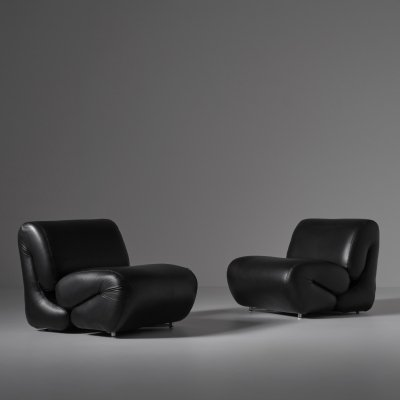 Sculptural leather lounge chairs, Italy 1970s