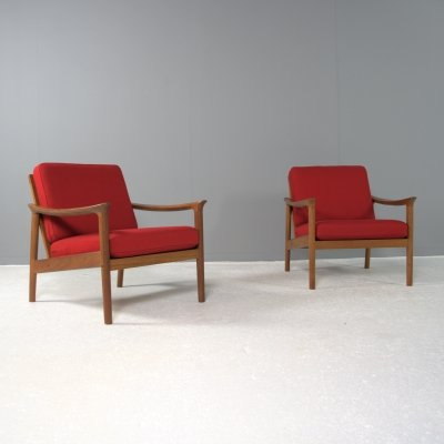 Set of 2 Mid Century Modern lounge chairs, marked made in Denmark