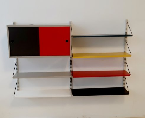Wall unit with multi color shelves & cabinet by Tjerk Reijenga for Pilastro, 1960s
