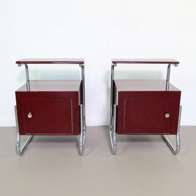 Pair of Rawi nightstands with a chrome tubular base, ca 1950