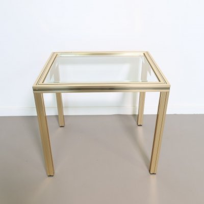 Pierre Vandel Brass side table with a glass top
