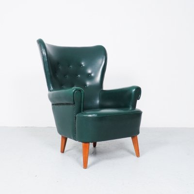 Green Artifort wingback lounge chair by Theo Ruth, 1950's