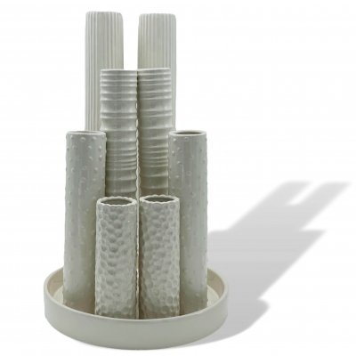 Sculptural composed of a circular plate containing 8 cylindrical flower vases