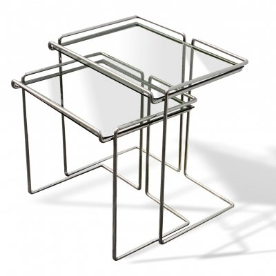 Set of two stackable coffee tables with chromed tubular base & glass shelves