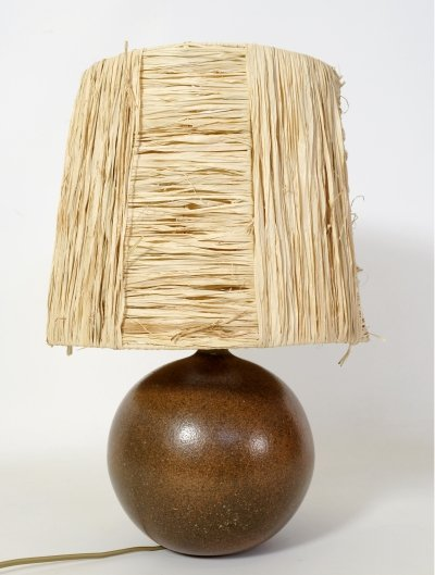 Stoneware round table lamp with a raffia shade