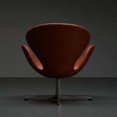First edition Arne Jacobsen Swan chair with original leather