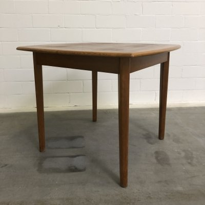 Teak wooden extendable dining table