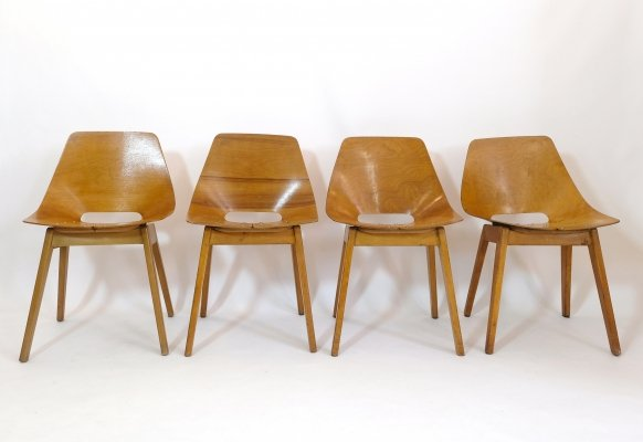 Set of 4 Pierre Guariche for Steiner 'Tonneau' chairs with wooden legs, 1950s