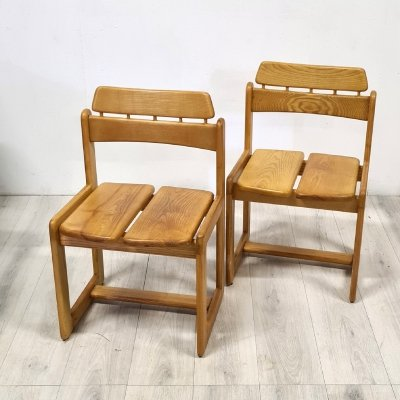 Set of two oak chairs by Ilmari Tapiovaara for Fratelli Montina, Italy 1970s