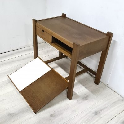 Modernist oak side table with serving trays, 1950s